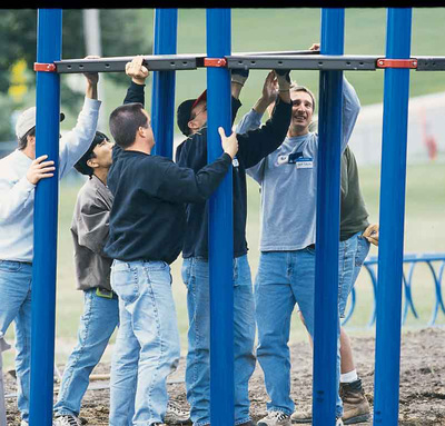 picture of men working on community build playground