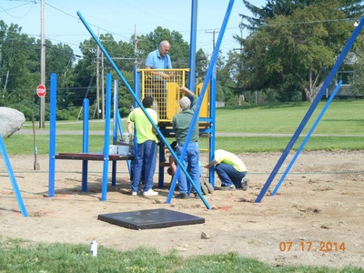 people building a playground