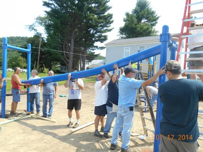 volunteers building playground photo
